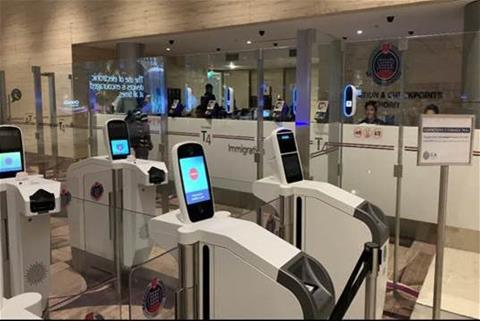 Automated immigration lanes with iris and facial scanning at Changi Airport T4